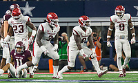 Hawgs Illustrated/Ben Goff<br /> De'Jon Harris (8), Arkansas linebacker, celebrates with teammates McTelvin Agim (3) and Santos Ramirez (9) after Arkansas sacking Texas A&M quarterback Kellen Mond (11) Saturday, Sept. 29, 2018, during the Southwest Classic at AT&T Stadium in Arlington, Texas.