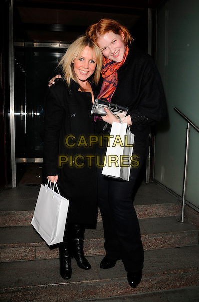 MIKYLA DODD & LISA?.Attending the Beat Eating Disorders Charity Event, The Met Bar, London, England, February 28th 2008..full length .CAP/CAN.?Can Nguyen/Capital Pictures