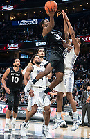 WASHINGTON, DC - JANUARY 28: Kamar Baldwin #3 of Butler sends up a shot past Terrell Allen #12 of Georgetown during a game between Butler and Georgetown at Capital One Arena on January 28, 2020 in Washington, DC.