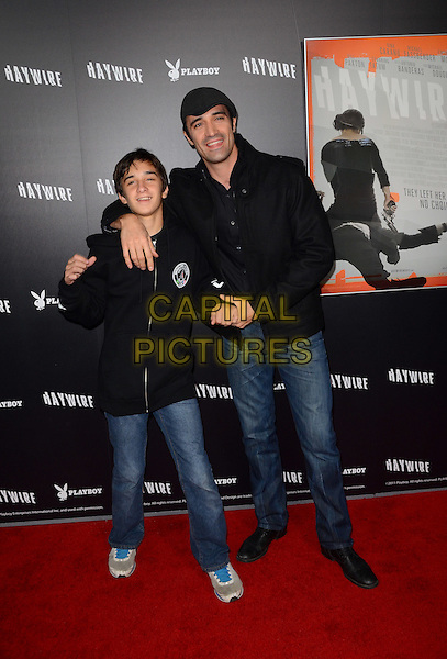 George Marini & Gilles Marini.The L.A. Premiere of 'Haywire' held at The DGA in West Hollywood, California, USA..January 5th, 2012.full length jacket father dad family hat cap grey gray black jeans denim arm son over shoulder .CAP/ADM/TW.©Tonya Wise/AdMedia/Capital Pictures.
