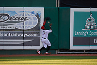 Lansing Lugnuts outfielder DJ Neal (7) crashes into the wall attempting to catch a fly ball during a Midwest League game against the Burlington Bees on July 18, 2019 at Cooley Law School Stadium in Lansing, Michigan.  Lansing defeated Burlington 5-4.  (Mike Janes/Four Seam Images)