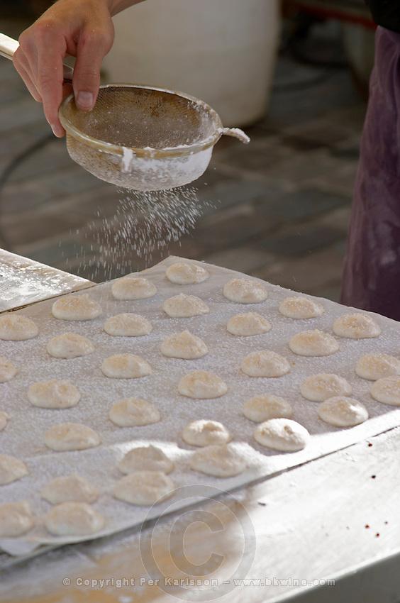 Making macarons almond bisquits, typical of Bordeaux and Saint Emilion. On a street market. On Les Quais. Bordeaux city, Aquitaine, Gironde, France
