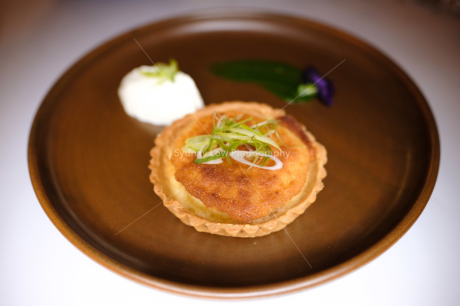 A comte and onion tart with an onion fondue at a dinner featuring Will Studd and Philippe Mouchel at Philippe Restaurant in Melbourne, Australia on 12 September 2017. Photo Sydney Low