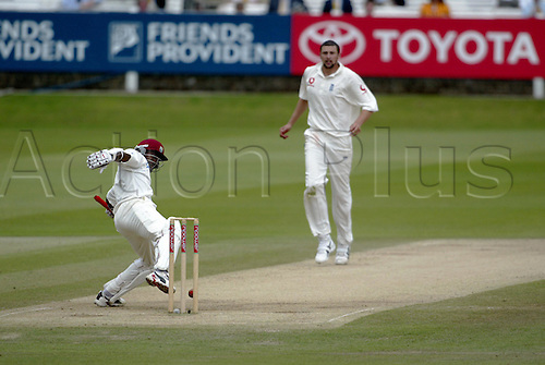 26 July 2004: West Indies Batsman BRIAN LARA kicks the ball away from his stumps on the final day but is unable to prevent England taking victory in the 1st npower Test  at Lords. Lara scored 11. Photo: Neil Tingle/Action Plus...040726 cricket cricketer batsman batting