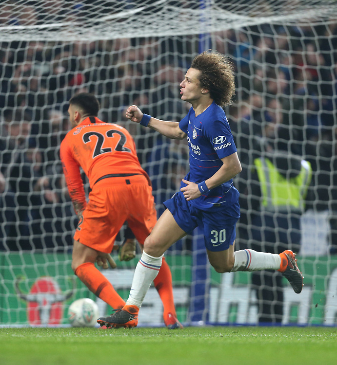 Chelsea's David Luiz celebrates after scoring the decisive penalty in the shoot-out<br /> <br /> Photographer Rob Newell/CameraSport<br /> <br /> The Carabao Cup Semi-Final Second Leg - Chelsea v Tottenham Hotspur - Thursday 24th January 2019 - Stamford Bridge - London<br />  <br /> World Copyright © 2018 CameraSport. All rights reserved. 43 Linden Ave. Countesthorpe. Leicester. England. LE8 5PG - Tel: +44 (0) 116 277 4147 - admin@camerasport.com - www.camerasport.com