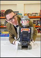BNPS.co.uk (01202 558833)<br /> Pic: PhilYeomans/BNPS<br /> <br /> Auctioneer Richard Edmonds with the 1960 vintage tin man robot.<br /> <br /> Take me to your leader - out of this world collection of rudimentary robots from the earliest days of sci-fi.<br /> <br /> The huge collection of over 500 classic sci-fi toys dates back to the 1950's and 60's and could now be worth a whopping &pound;30,000.<br /> <br /> The huge collection was started by a robot mad schoolboy in the 1950's as the Russian Sputnik satellite kick started the race for space and sparked huge interest in science fiction.<br /> <br /> The oldest items date from the late 1950's with models continuing all the way through to the 1990s with several classic favourites included.<br /> <br /> There are a number of lots related to TV classic Thunderbirds and a model of Robbie the Robot, who featured in the TV series Lost in Space and the film Forbidden Planet remains in terrific condition.