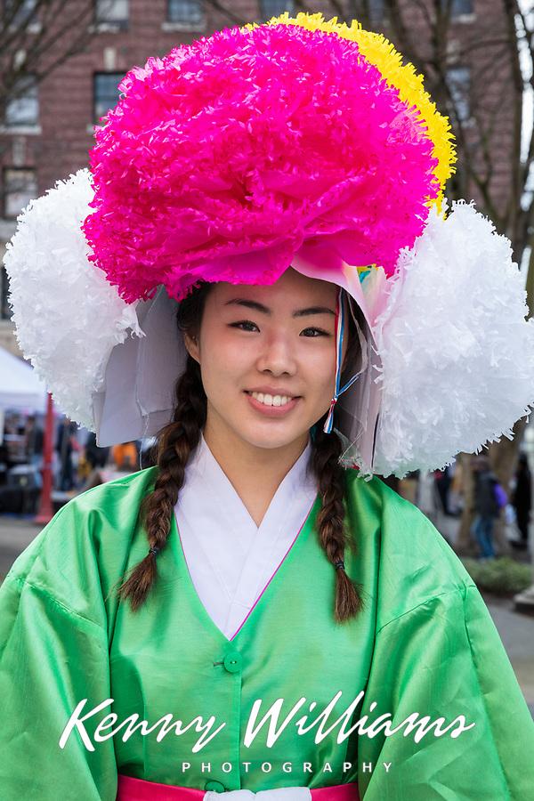 Beautiful asian girl wearing Korean traditonal outfit, Chinese New Year Celebration, Chinatown, Seattle, WA, USA.