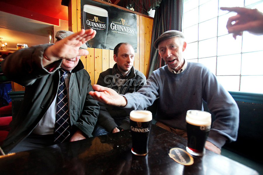 4/10/2010.  Horse traders talk business over a few pints of Guinness in the Emerald Bar at the Ballinasloe Horse Fair, Ballinasloe, Ireland. Picture James Horan