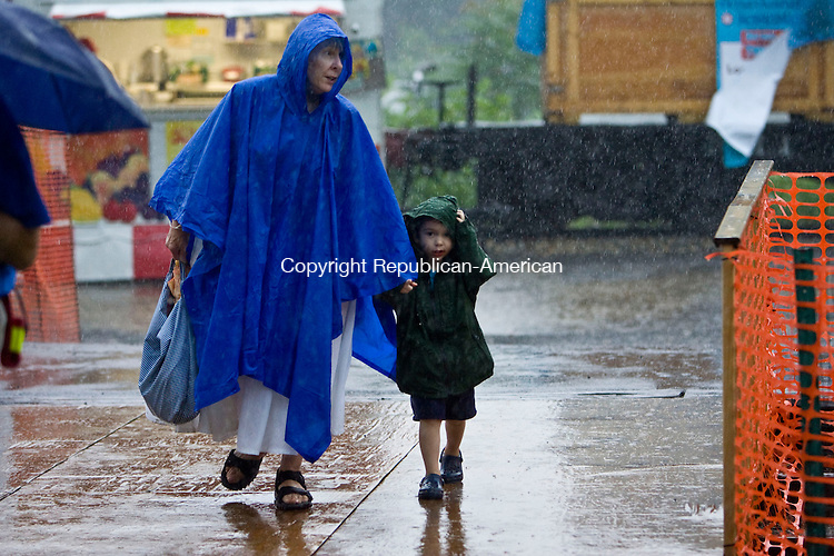 THOMASTON, CT - 31 JULY 2009 -073109JT09-<br /> Sharon Welton of Thomaston walks with her grandson Patrick Welton, 3, of Plymouth, in the pouring rain as he points to a tent filled with Thomas the Tank Engine toys at the New England Railroad Museum in Thomaston during Friday's Day out with Thomas the Tank Engine. The event will continue through Sunday, and will resume next Friday through Sunday, rain or shine.<br /> Josalee Thrift Republican-American