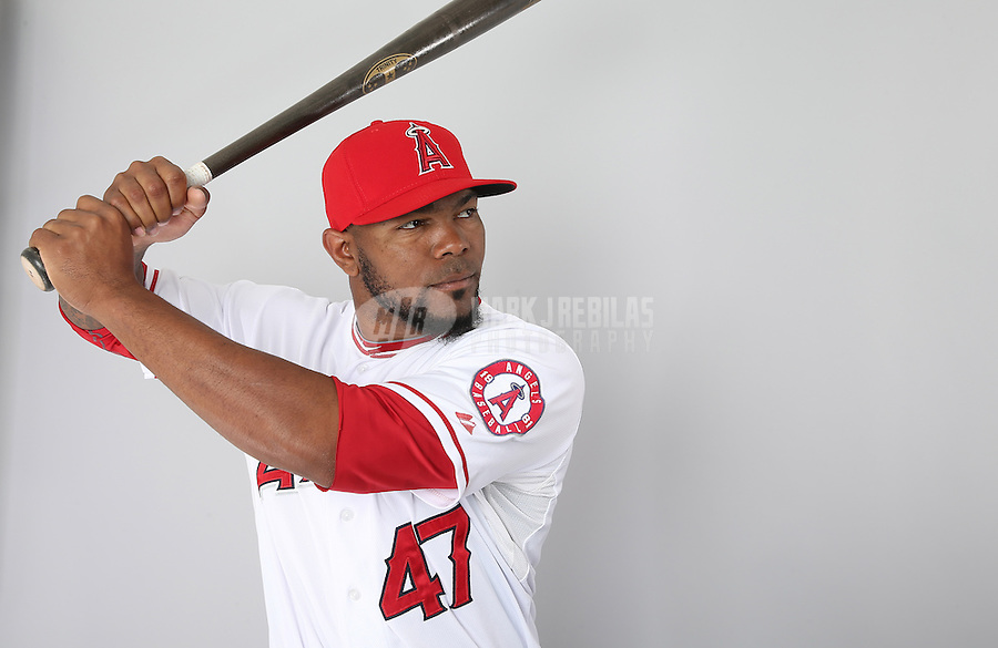 Feb. 21, 2013; Tempe, AZ, USA: Los Angeles Angels infielder Howie Kendrick poses for a portrait during photo day at Tempe Diablo Stadium. Mandatory Credit: Mark J. Rebilas-
