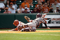 Texas designated hitter Jonathan Walsh #33 slides head-first into home past Texas A&M catcher Cole Lankford #12 to score the winning run in the bottom of the ninth inning ending the NCAA baseball game on April 29, 2012 at UFCU Disch-Falk Field in Austin, Texas. The Longhorns rallied for 2 runs in the last inning beat the Aggies 2-1 in the final regular season game scheduled for the long time rivals. (Andrew Woolley / Four Seam Images)