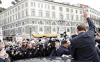 Il leader del Popolo della Liberta' Silvio Berlusconi saluta i suoi simpatizzanti dopo aver presentato il Camper della Liberta' in Piazza del Popolo, Roma, 12 marzo 2008..Leader of the People of Freedom's center-right coalition Silvio Berlusconi, right, back to camera, waves to sympathizers after presenting the Camper of Freedom in Rome's Piazza del Popolo, 12 march 2008..UPDATE IMAGES PRESS/Riccardo De Luca