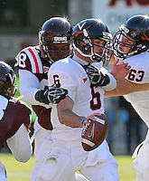 Nov 27, 2010; Charlottesville, VA, USA;  Virginia Cavaliers quarterback Marc Verica (6) is sacked by Virginia Tech Hokies defensive tackle Derrick Hopkins (98) during the game at Lane Stadium. Virginia Tech won 37-7. Mandatory Credit: Andrew Shurtleff-