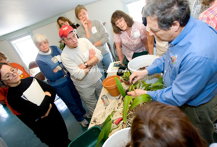 LITCHFIELD, CT- 22 APRIL 07- 042207JT05- <br /> Steve Frowine, at right, holds a hands-on orchid workshop at White Flower Farm in Litchfield on Saturday April 21.<br /> Josalee Thrift Republican-American