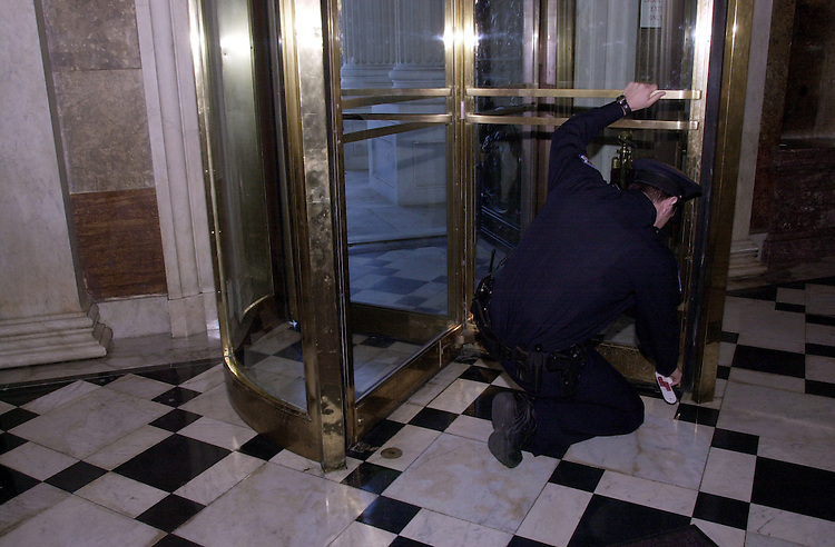2recess110100 -- U.S. Capitol Policemen Frank Spizuoco, locks down the Senate after they recessed until November 14 2000.