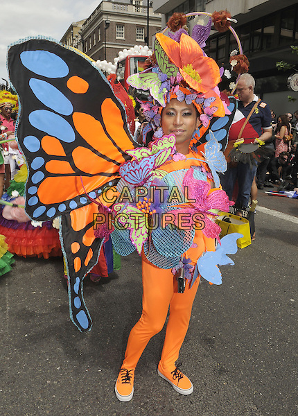 Pride London 2013 Parade through the streets of the capital to support Gay rights. An estimated 25,000 people took part. <br /> London, UK, 29th June 2013.<br /> butterfly costume <br /> CAP/PP/BK<br /> &copy;Bob Kent/PP/Capital Pictures