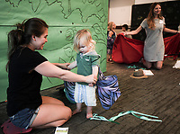 NWA Democrat-Gazette/CHARLIE KAIJO Sharlotte Fedewa (left) puts butterfly wings on Sage DeSoiner, 2, of Bentonville during a preschool costume event, Thursday, September 13, 2018 at Crystal Bridges in Bentonville.<br /><br />Kids had the opportunity to create stories with creative play and outfits.