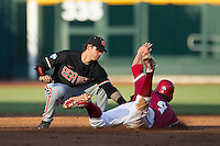 Oregon State shortstop Tyler Smith (1) tags Indiana outfielder Chris Sujka (4) as he slides into second base during Game 9 of the 2013 Men's College World Series  on June 19, 2013 at TD Ameritrade Park in Omaha, Nebraska. The Beavers defeated the Hoosiers 1-0, eliminating Indiana from the tournament. (Andrew Woolley/Four Seam Images)