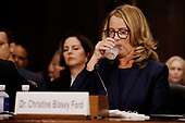 Professor Christine Blasey Ford, who has accused U.S. Supreme Court nominee Brett Kavanaugh of a sexual assault in 1982, takes a drink prior to testifying before a Senate Judiciary Committee confirmation hearing for Kavanaugh on Capitol Hill in Washington, U.S., September 27, 2018. REUTERS/Jim Bourg