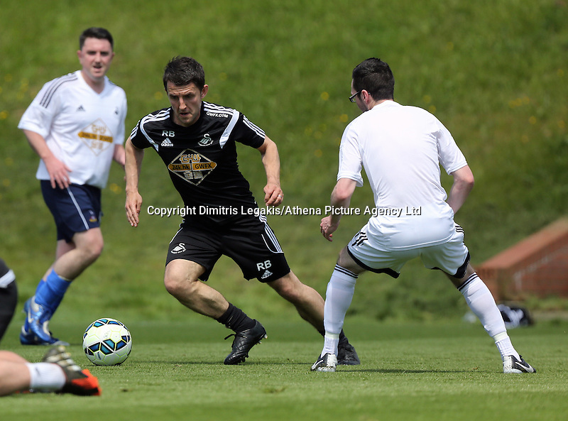 Pictured: Richard Buchanan and Ben DonovanThursday 21 May 2015<br /> Re: Sports reporters v Swansea City FC members of coaching staff football game at Fairwood Training ground.