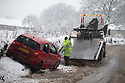 21/01/15<br /> <br /> A car is recovered after skidding off the road near Monsal Head in Derbyshire.<br /> <br /> More than 20 schools in Derbyshire were closed today following overnight snowfall that continued into the morning across the Peak District.<br /> <br /> All Rights Reserved - F Stop Press.  www.fstoppress.com. Tel: +44 (0)1335 300098