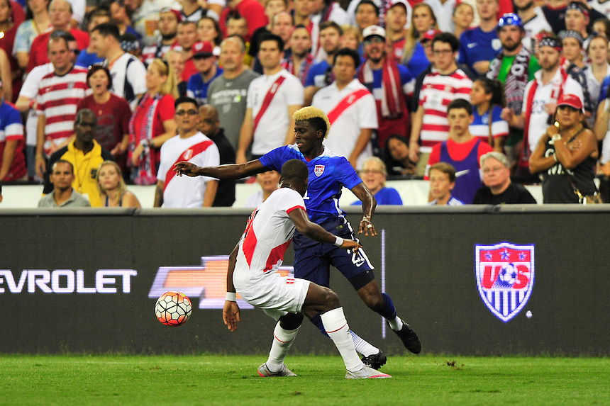Gyasi Zarde of US tries to elude a defender. USA defeated Peru 2-1 during a Friendly Match at the RFK Stadium in Washington, D.C. on Friday, September 4, 2015.  Alan P. Santos/DC Sports Box