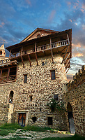 Picture &amp; image of David Gareja Georgian Orthodox monastery, Mount Gareja, Kakheti Region, Georgia (country). 25 km (15 miles) from Gardabani<br /> <br /> Founded in the 6th century by David (St. David Garejeli), one of the  thirteen Assyrian monks who built monasteries throughout Georgia. The 24 plus monasteries of David Gareja are spread out over a huge area of the arid Mount Gareja ridge, with small cells and chapels cut into cliff faces.