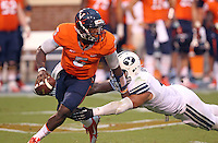 Virginia quarterback David Watford (5) is pressured by Brigham Young linebacker Kyle Van Noy (3) during the first half of the game in Charlottesville, Va. Virginia defeated Brigham Young 19-16. Photo/Andrew Shurtleff