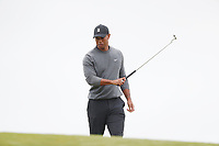 Tiger Woods (USA) reacts to missing a putt on the first hole during the second round of the 118th U.S. Open Championship at Shinnecock Hills Golf Club in Southampton, NY, USA. 15th June 2018.<br /> Picture: Golffile | Brian Spurlock<br /> <br /> <br /> All photo usage must carry mandatory copyright credit (&copy; Golffile | Brian Spurlock)