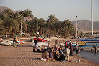 Aqaba's waterfront is a mix of people, camels, and boats.