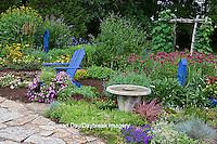 63821-21812 Flower garden with stone path, blue Adirondack chair, bird bath, butterfly house, bird house, and trellis, Purple Verbena, sedums, blue fescue grass, raspberry blast petunia and diamond frost euphorbia in blue pot, Butterfly Bushes, Joe Pye Weed (Eupatorium purpurea) Moon Vine on trellis, Raspberry Wine Bee Balm (Monarda didyma)  Marion Co., IL