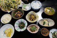 A meal of cooked mountain vegetables at the Ashiya guesthouse. Tsuruoka, Yamagata Prefecture, Japan, April 9, 2016. The city of Tsuruoka in Yamagata Prefecture is famous for its sansai mountain vegetable cuisine. These foraged grasses, fungi and vegetables are also used by the mountain ascetics of the Shugendo religion.