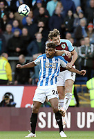 Huddersfield Town's Steve Mounie vies for possession with Burnley's James Tarkowski<br /> <br /> Photographer Rich Linley/CameraSport<br /> <br /> The Premier League - Burnley v Huddersfield Town - Saturday 6th October 2018 - Turf Moor - Burnley<br /> <br /> World Copyright &copy; 2018 CameraSport. All rights reserved. 43 Linden Ave. Countesthorpe. Leicester. England. LE8 5PG - Tel: +44 (0) 116 277 4147 - admin@camerasport.com - www.camerasport.com