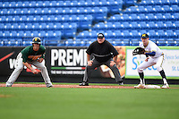 Michigan Wolverines first baseman Jacob Cronenworth (2) holds on Brian Fay (28) leading off as umpire Dorsey Hager looks on during the first game of a doubleheader against the Siena Saints on February 27, 2015 at Tradition Field in St. Lucie, Florida.  Michigan defeated Siena 6-2.  (Mike Janes/Four Seam Images)