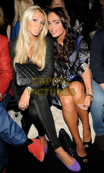 PETRA & TAMARA ECCLESTONE .At the Issa Show, London Fashion Week Day 3, Somerset House, London, England, UK,.September 20th 2009..full length black chanel bag sisters family gold wrist watch blue print dress leather jacket sitting purple shoes peep toe suede leggings .CAP/CAN.©Can Nguyen/Capital Pictures.