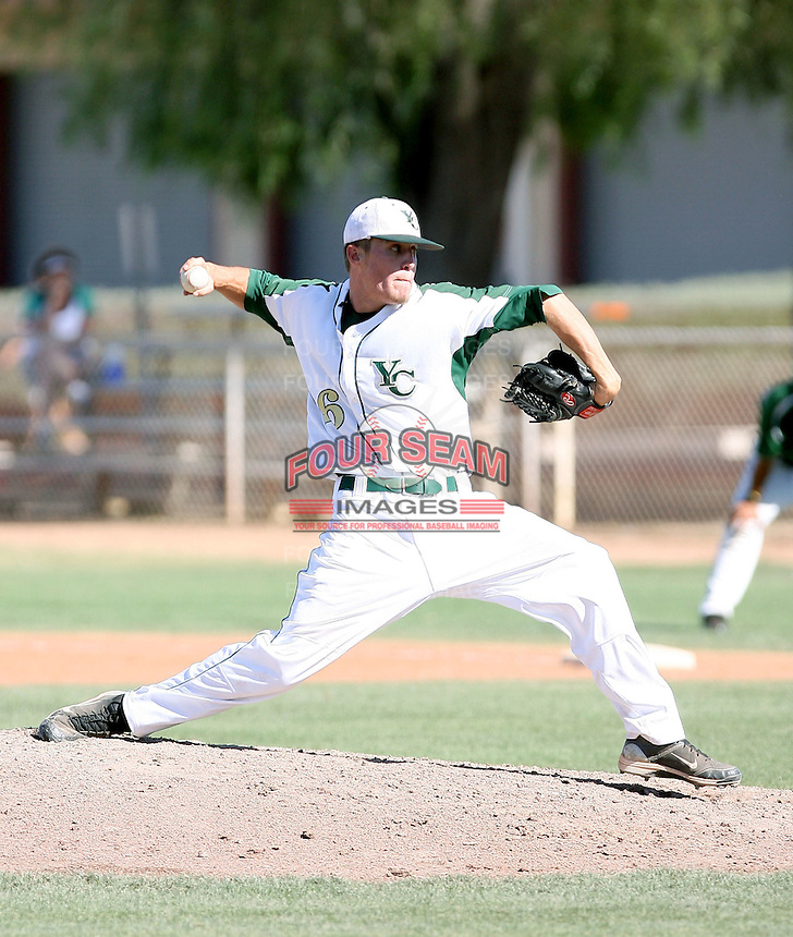 Kenny Giles #26 of the Yavapai College Roughriders pitches against the Central Arizona College Vaqueros at Central Arizona's home field on May 13, 2011 in Coolidge, Arizona. Central Arizona defeated Yavapai, 1-0, to clinch the regional championship..Photo by:  Bill Mitchell/Four Seam Images.