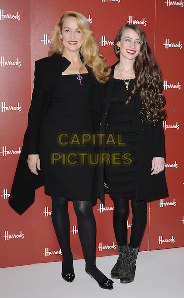 JERRY HALL & ELIZABETH JAGGER.open Harrods Winter Sale, knightsbridge, london, England 27th December 2010.lizzie lizzy full length mother mom mum daughter family black dress coat jacket  boots tights leggings .CAP/CAN.©Can Nguyen/Capital Pictures.