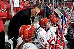 MADISON, WI - SEPTEMBER 29: Assistant coach Dan Koch of the Wisconsin Badgers women's hockey talks to a player during the game against the Quinnipiac Bobcats at the Kohl Center on September 29, 2006 in Madison, Wisconsin. The Badgers beat the Bobcats 3-0. (Photo by David Stluka)