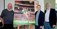Local artist Paul Downey with his portrait of Kerry footballer Colm 'Gooch' Cooper at Killarney Library on Tuesday evening, also in the picture is Jimmy O'Shea who gifted this painting to the Killarney Library.<br /> Photograph by Sally MacMonagle-MacMonagle Photography