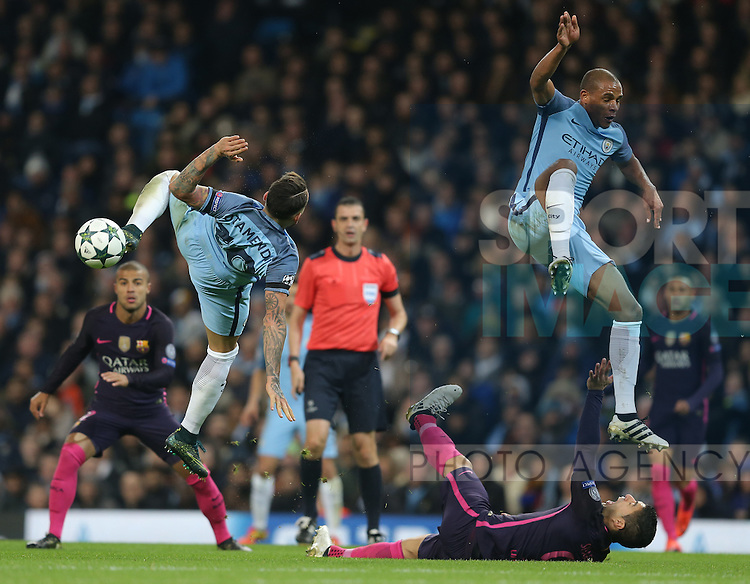 Nicolas Otamendi of Manchester City and Fernandinho of Manchester City control Luis Suarez of Barcelona during the Champions League Group C match at the Etihad Stadium, Manchester. Picture date: November 1st, 2016. Pic Simon Bellis/Sportimage