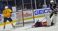 Steven McKnight of the Buffalo High School All Star team scores the game winning goal against the Rochester High School All Star team to win the Scotty Bowman Cup on February 12,2012