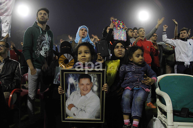 "Relatives of al-Ahly fans, who were killed in what known as the ""Port Said massacre"", attend the third anniversary of killing their relatives at al-Ahly club's training stadium, on February 1, 2015. On 1 February 2012, a massive riot occurred at Port Said Stadium in Port Said city, Egypt, following an Egyptian Premier League football match between El Masry and El Ahly clubs. At least 74 people were killed and more than 500 were injured after thousands of El Masry spectators stormed the stadium stands and the pitch. Photo by Amr Sayed"