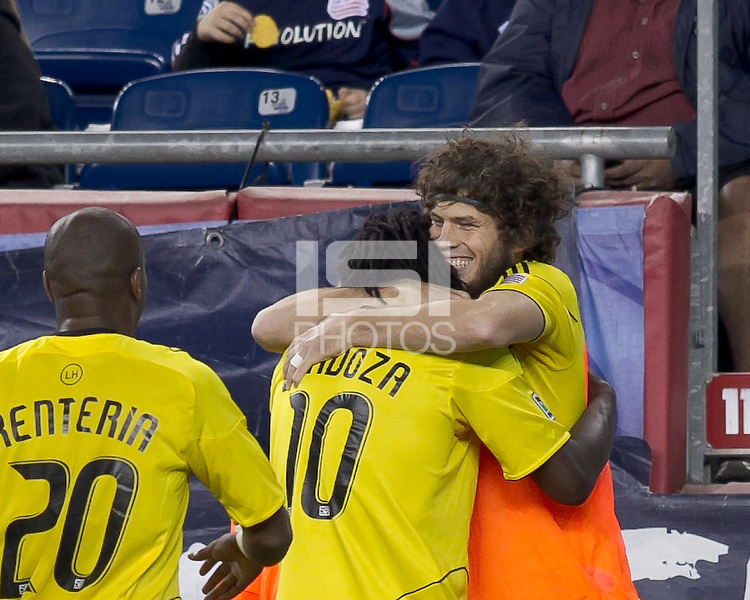 Columbus Crew forward Andres Mendoza (10) one times a pass for a goal and celebrates his goal with teammates.  In a Major League Soccer (MLS) match, the Columbus Crew defeated the New England Revolution, 3-0, at Gillette Stadium on October 15, 2011.