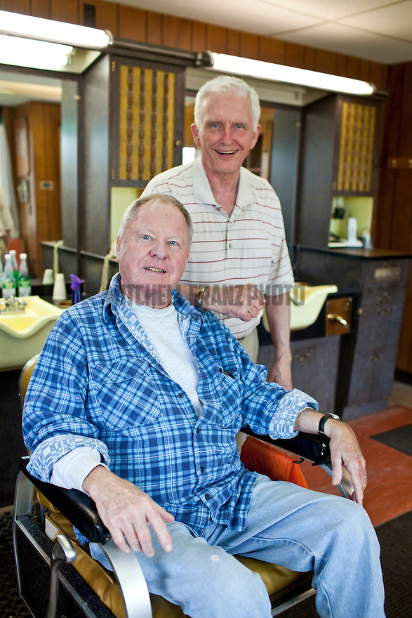 Vincent Moriarty and John Murray pose together at Murray's Barbershop. Moriarty often visits in the afternoons. The two tease each other in fun, discuss the world's latest issues and recount old stories.
