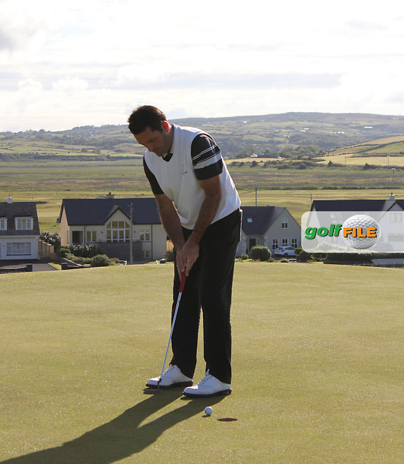 Gary O' Flaherty (Cork) on the 1st green during Matchplay Round 3 of the South of Ireland Amateur Open Championship at LaHinch Golf Club on Saturday 25th July 2015.<br /> Picture:  Golffile | TJ Caffrey