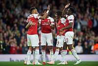 Pierre-Emerick Aubameyang of Arsenal celebrates his second goal with Danny Welbeck of Arsenal and teammates during the UEFA Europa League match group between Arsenal and Vorskla Poltava at the Emirates Stadium, London, England on 20 September 2018. Photo by Andrew Aleks / PRiME Media Images.