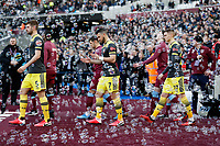 29th February 2020; London Stadium, London, England; English Premier League Football, West Ham United versus Southampton; Jack Stephens, Shane Long and Will Smallbone of Southampton walking out onto the pitch from the tunnel through a wall of bubbles
