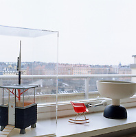 A miniature Eames chair and a model coastguard's lookut post are displayed on the windowsill