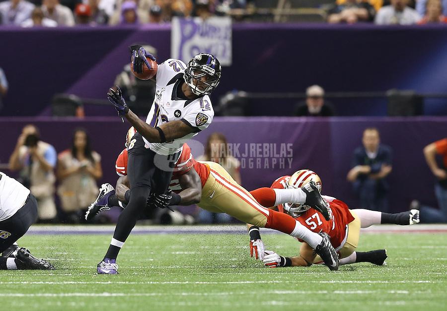Feb 3, 2013; New Orleans, LA, USA; Baltimore Ravens wide receiver Jacoby Jones (12) against the San Francisco 49ers in Super Bowl XLVII at the Mercedes-Benz Superdome. Mandatory Credit: Mark J. Rebilas-