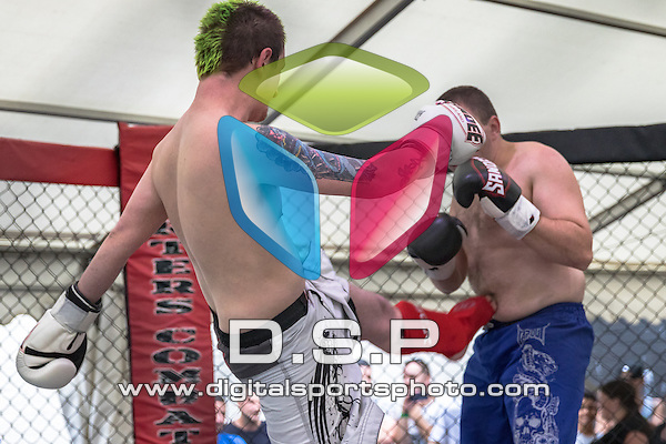 Simon Newland VS Tyrone Cooper. Photo by: Stephen Smith<br /> <br /> UK Hardest Man: Shark Tank - Saturday 11th July 2015. The Sobar, Southampton, Hampshire, United Kingdom.